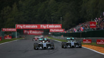 Lewis Hamilton (GBR) and Nico Rosberg (GER) battle for position leading to contact, 24.08.2014, Belgian Grand Prix, Spa Francorchamps / XPB