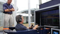 BBC Science Correspondent Jonathan Amos tries the BLOODHOUND Driving Expreience under the watchful eye of Andy Green at Farnborough on 19.07.2010