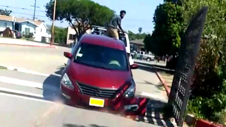 Nissan Owner Tries To Free His Altima From Moving Repo Tow Truck
