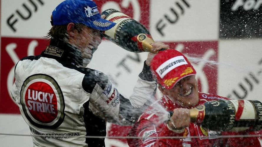 Brawn bets each-way on Button title, Schu win